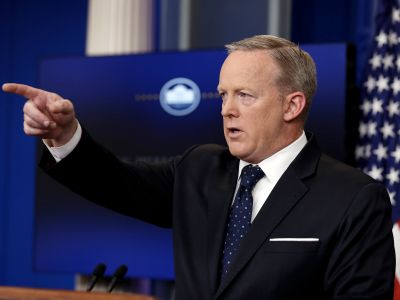 Sean Spicer faced on-camera questions for the first time in 8 days, and he won't say if Trump believes Russia interfered in the election
