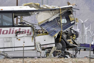 The Latest: Officials: No evidence bus braked before crash