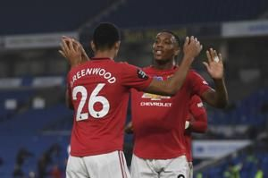 Soccer-Fernandes double steers Man United to 3-0 win at Brighton