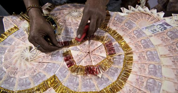 Indian rupee falls to all-time low against dollar