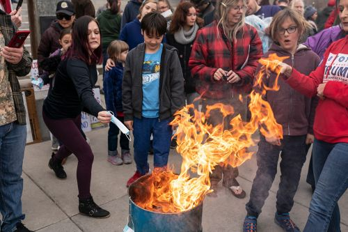 'I will not self-suffocate': Idaho protesters burn masks at state capital