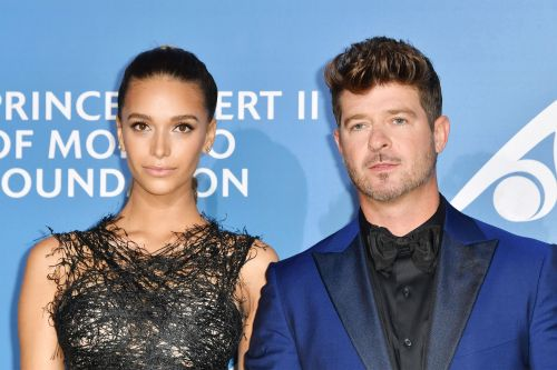 Robin Thicke's girlfriend shows home destroyed in wildfire