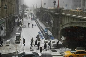 Winter storm closes schools, snarls travel across much of US