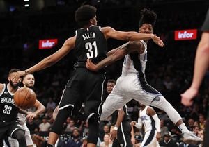 Nets beat Magic 126-121 in first game without Lin