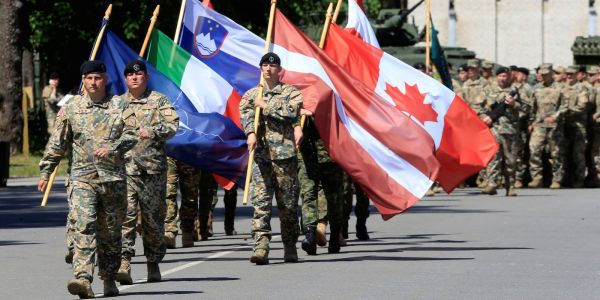 NATO's top officer says we're living with 'a more blurred line between peace and war' - thanks to new Russian tactics