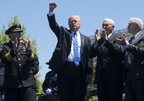 Trump reluctantly grants sanctions waivers to Iran, keeps U.S. in nuclear deal