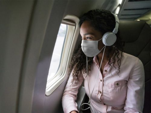 The CDC strongly recommends you do not travel this holiday season, but if you must, here's the coronavirus safety gear travel medicine experts recommend you pack