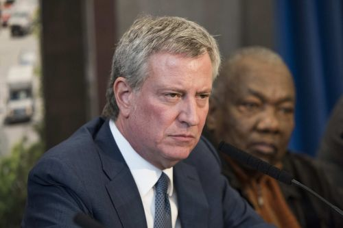 City worker got raise for 'protecting' de Blasio from probe: suit
