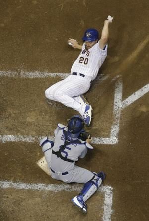 Machado shines in Dodger debut as LA beats Brewers 6-4