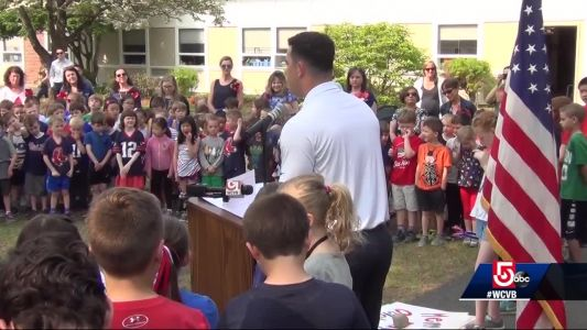 Patriots player in Naval Reserve joins Memorial Day school ceremony
