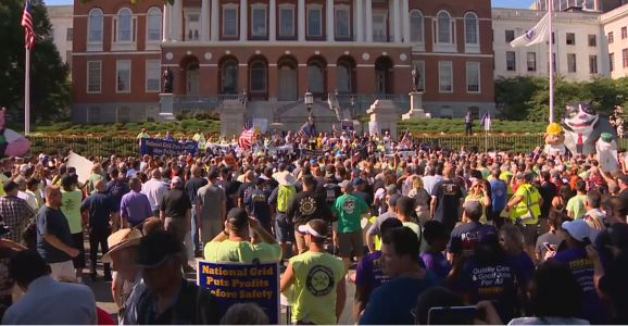 Hundreds march in Boston over dispute between locked-out workers, National Grid