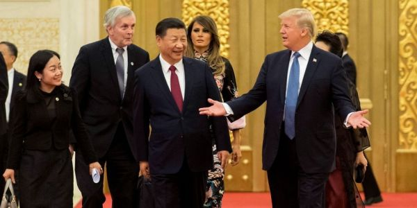 A Secret Service agent tackled a Chinese security official over the nuclear football when Trump visited China
