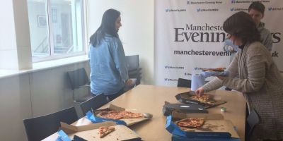 The Boston Globe sent pizza to a Manchester newspaper in a gesture of solidarity