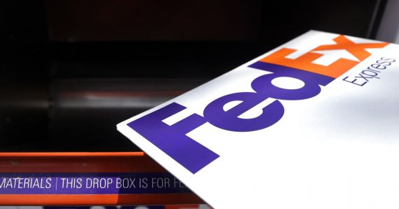 FedEx beats profit forecasts, raises 12-month outlook