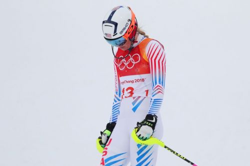 Lindsey Vonn blows good shot at gold in final Olympic event when she clipped a gate, giving silver to Mikaela Shiffrin
