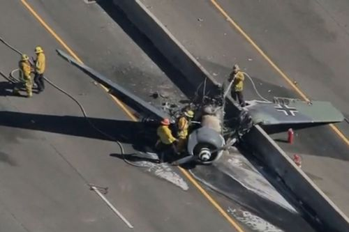Vintage WWII plane crashes on freeway, bursts into flames