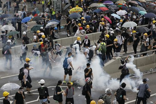 Hong Kong leader delays unpopular extradition bill; activists want more