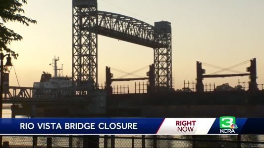 Ship traffic passes under Rio Vista bridge