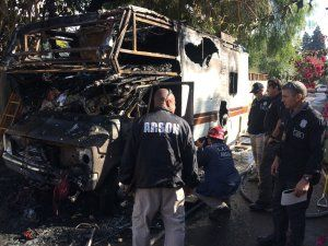 Man dies after trying to rescue dogs from burning RV