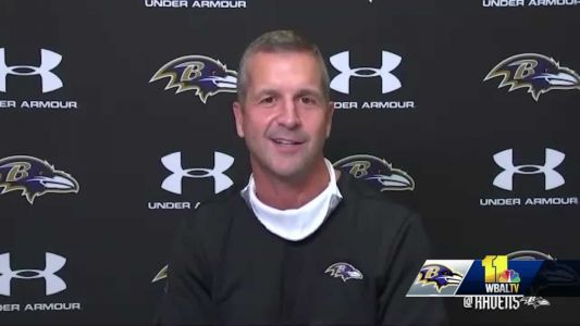 Ravens coach John Harbaugh, wife pay everyone's restaurant tab