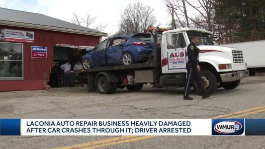 Car crashes through wall of Laconia business