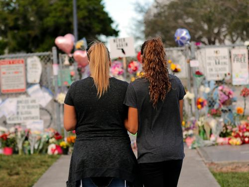 More than 100 airline employees went to the funeral for a Florida school shooting victim whose father is a United pilot