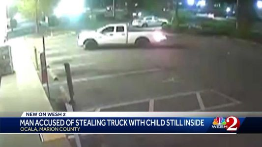 Man accused of stealing truck with child still inside