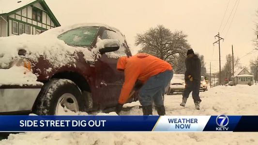 Omaha drivers dig out from side streets after latest snowfall