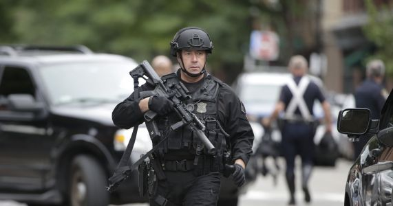 Boston officer shot, 3 suspects taken into custody