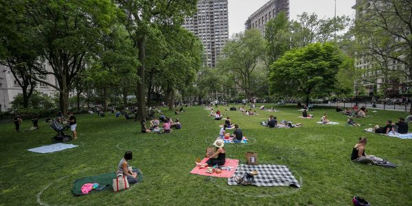 New York is relaxing restrictions on group gatherings as the state sees its lowest single-day death toll since March