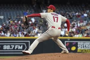 Ohtani delivers on mound, at plate as Angels top D-backs 6-5