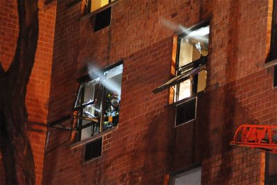 Woman dies from apartment fire likely started by cigarette