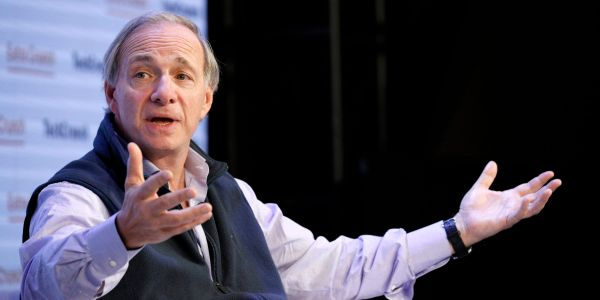 Billionaire Ray Dalio says the US government's big fiscal push could cause the economy to overheat and the dollar to fall