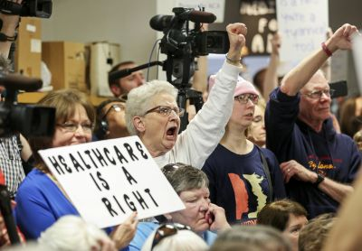 GOP members of Congress meet with protests at town halls