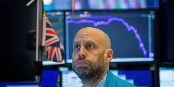 Dow tumbles 423 points amid record COVID-19 cases and fading stimulus hopes