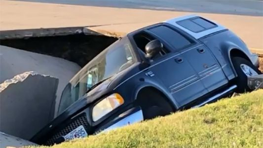 Driver happy to be alive after sinkhole swallows pickup truck he was in