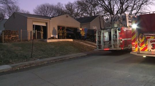 Garage fire singes side of house near 34th, Washington streets