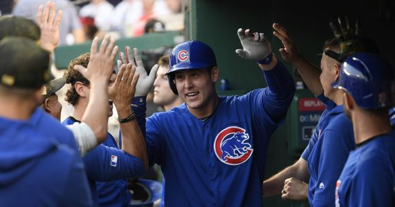 Rizzo homers, Cubs hold off Nationals' rally for 6-5 win