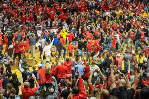 Losing NCAA hoops player punches court-storming fan