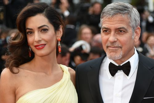 George and Amal Clooney donate $100K to help migrant children