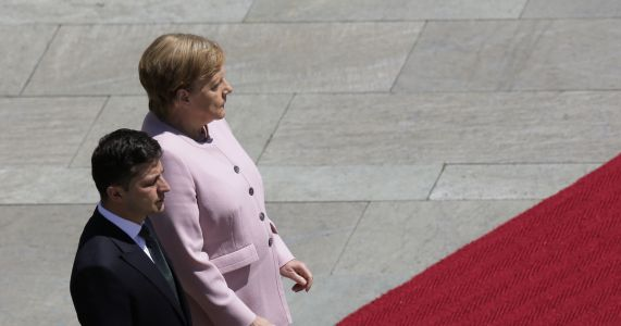 Germany's Merkel appears unsteady, shaking at ceremony