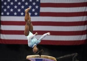 "Biles dresses ""for the survivors"" while winning 5th US title"