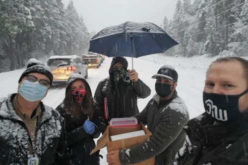 Health workers stuck in snowstorm go car-to-car giving COVID-19 vaccine