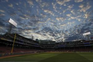 The Latest: Fans advised to take cover at Fenway before game