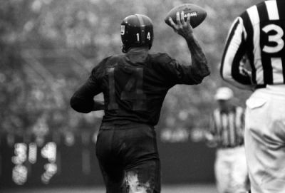 New York Giants quarterback Y.A. Tittle, covered in mud, looks