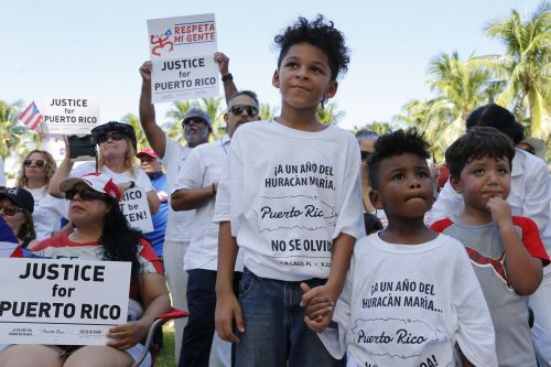 Hundreds mark Hurricane Maria anniversary near Trump resort