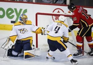 Rinaldo scores in 3rd, Predators beat Flames 5-3