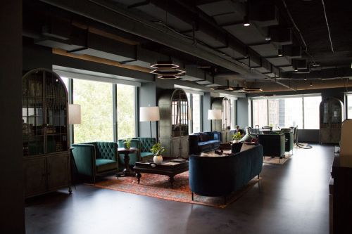 Take a look inside Johnson & Johnson's new startup incubator in NYC's SoHo neighborhood, that feels more like a rustic-chic coffee shop with jewel-toned couches