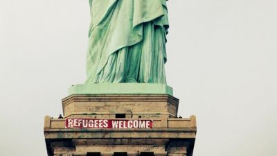 Activists Hang 'Refugees Welcome' Banner From Statue Of Liberty
