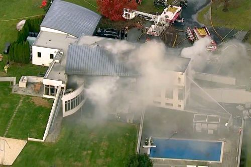 Brother charged after family found dead in Colts Neck mansion fire